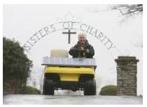 Sister Paula riding solar-powered golf cart